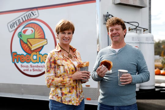 Lorena, left, and Billy Smith stand in front of their FreeChee trailer in this file photo in Lancaster. The Smiths travel around the country to disaster areas to offer people free tomato soup, grilled cheese and a smile. The Smiths and their trailer made a trip recently to Tennessee after the tornado hit there, but now they have set up locally due to the coronavirus to help feed people.
