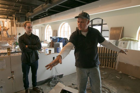 Marcus Goller, foreground, and his son Spencer, talk Wednesday, Nov. 7, 2018 about plans for the soon-to-open Brighton Coffeehouse and Theater.