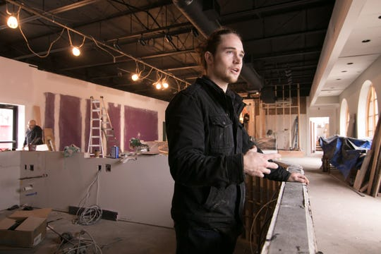 Spencer Goller, store manager of the soon-to-open Brighton Coffeehouse and Theater, talks about the layout of the bar he stands behind Wednesday, Nov. 7, 2018.