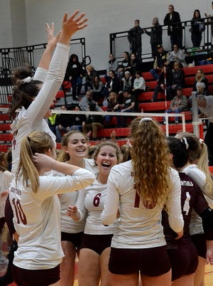 Charyl Stockwell celebrates a 28-26, 25-23, 25-23 victory over Adrian Madison in the regional volleyball semifinals.