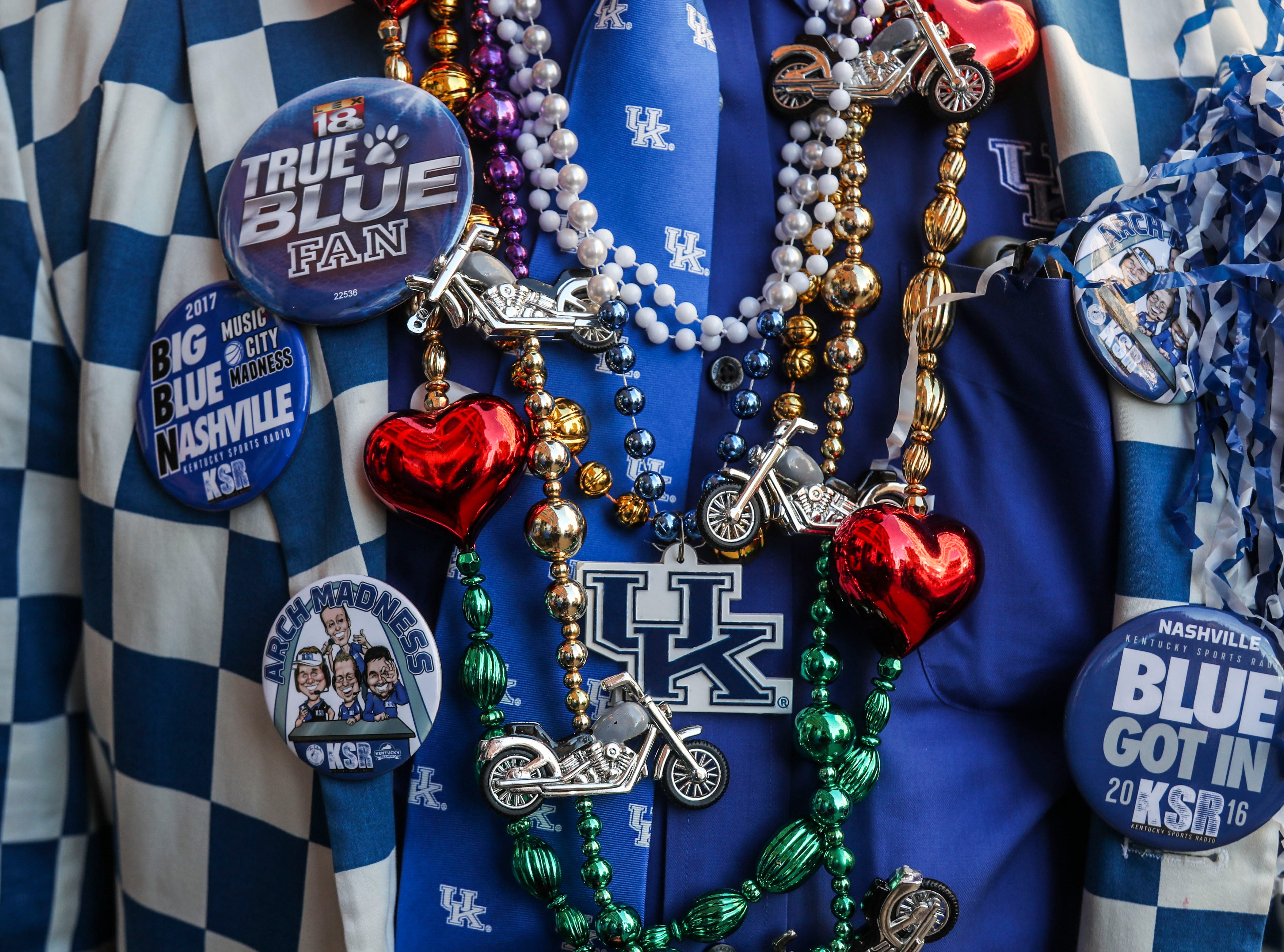 Kentucky fan Keith Lowery of Pilot Oak, Ky. wore a checkerboard blue-and-white suit while greeting fellow Wildcat fans before the Champions Classic Tuesday night in Indianapolis.