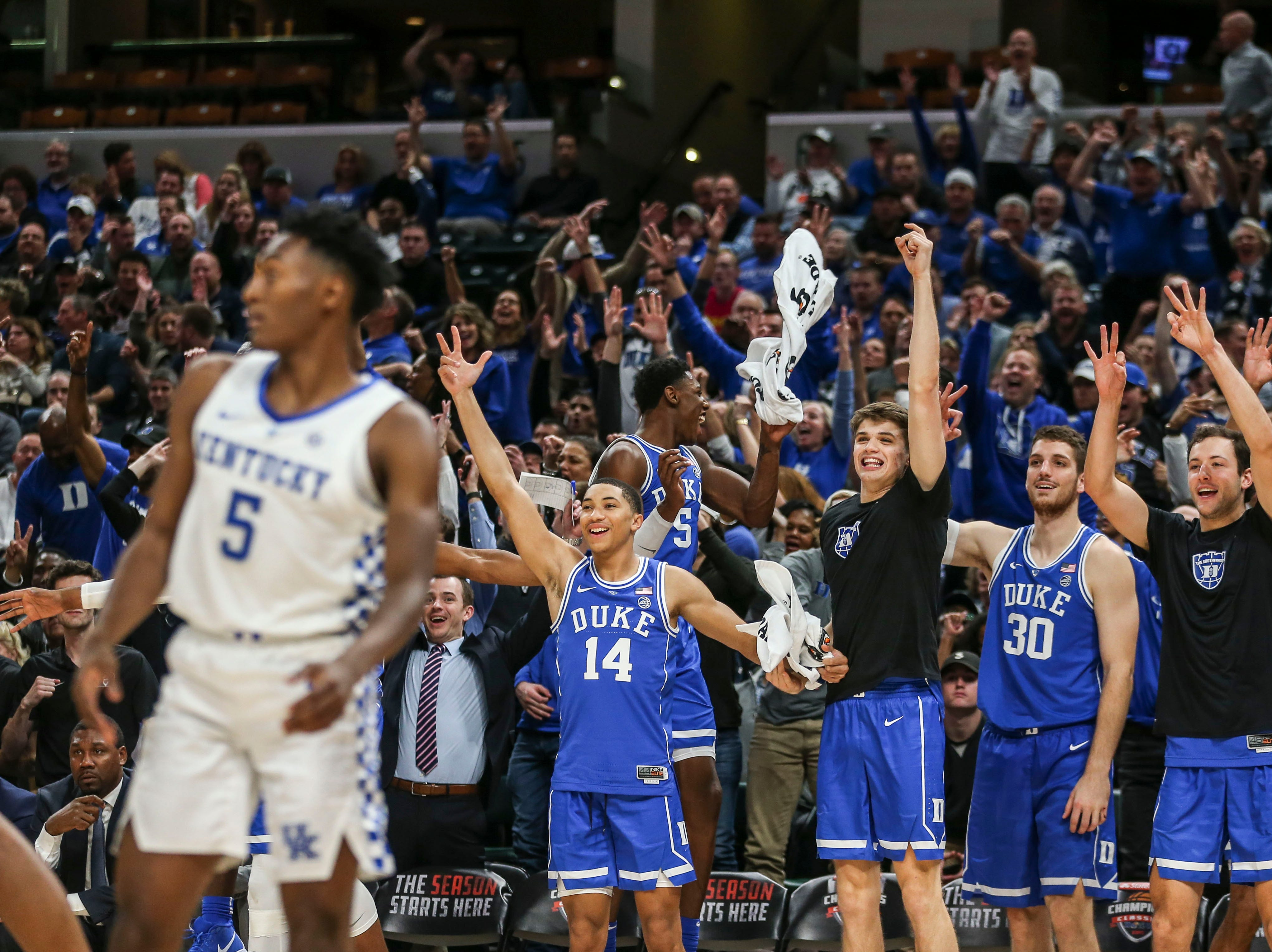 The Duke bench celebrate behind Kentucky's Immanuel Quickly as the Blue Devils routed the Wildcats 118-84 in the Champions Classic Tuesday night. Nov. 6, 2018