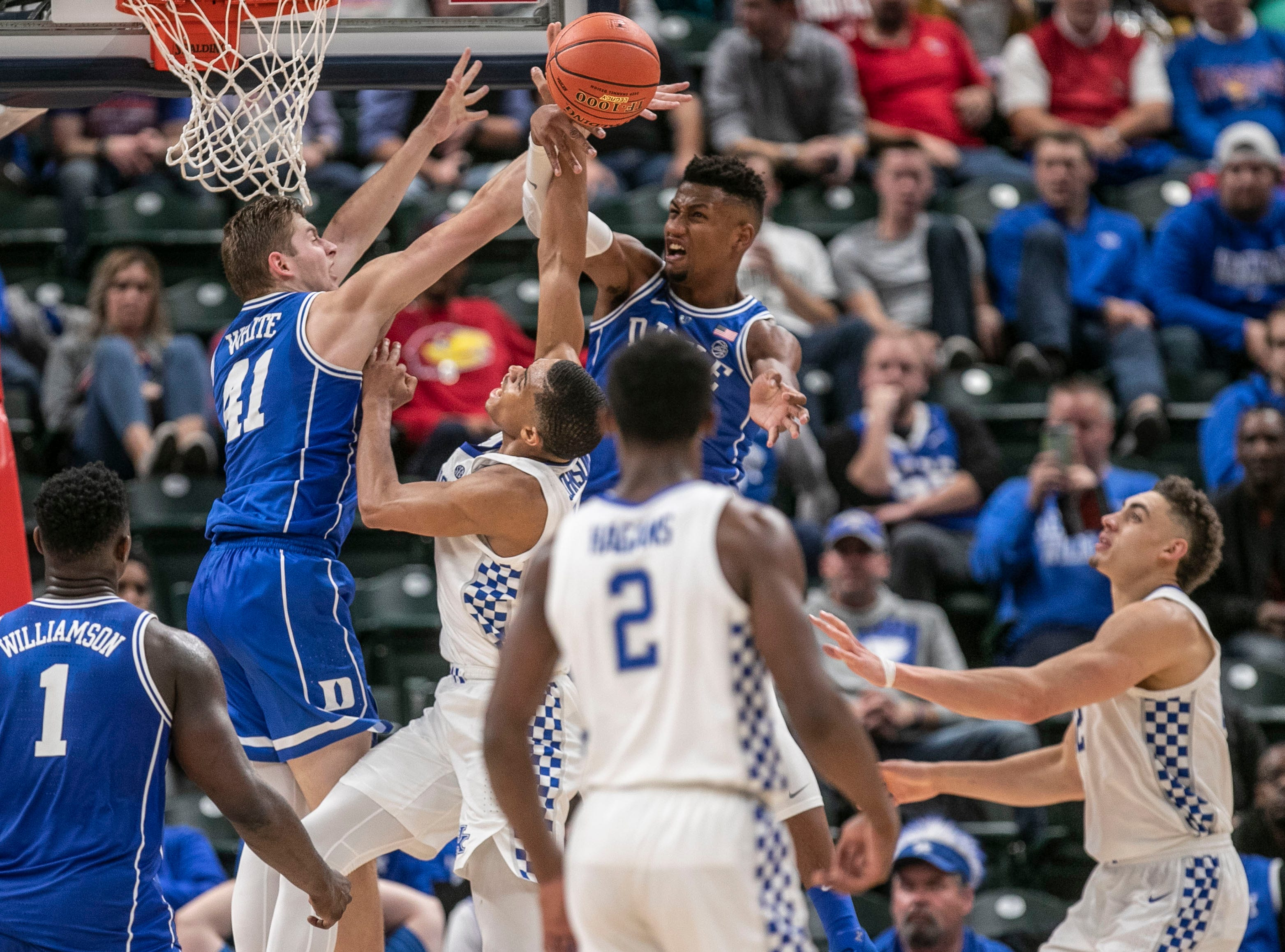 Duke's Javin DeLaurier blocked the shot of Kentucky's Keldon Johnson as the Blue Devils rolled past the Wildcats 118-84 in the Champions Classic Tuesday night. Nov. 6, 2018
