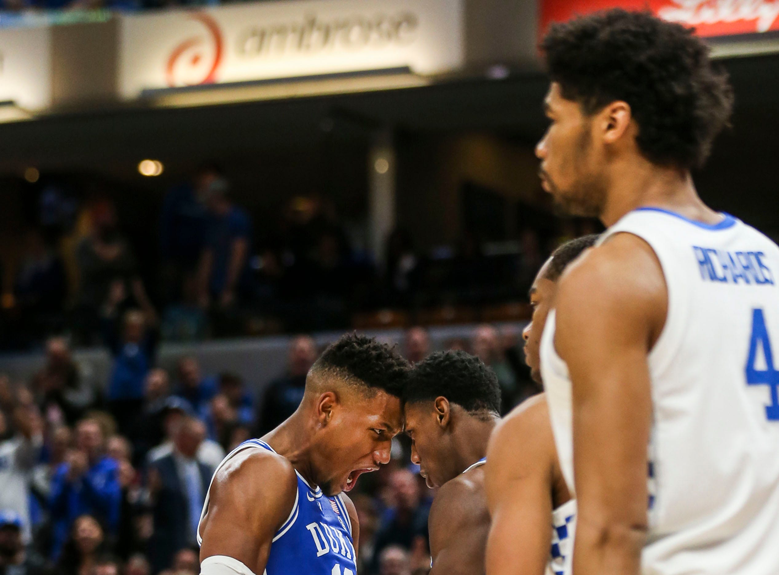 Duke's Javin Delaurier, left, celebrates with R.J. Barrett as the Blue Devils cruised past Kentucky 118-84 in the Champions Classic Tuesday night. Nov. 6, 2018