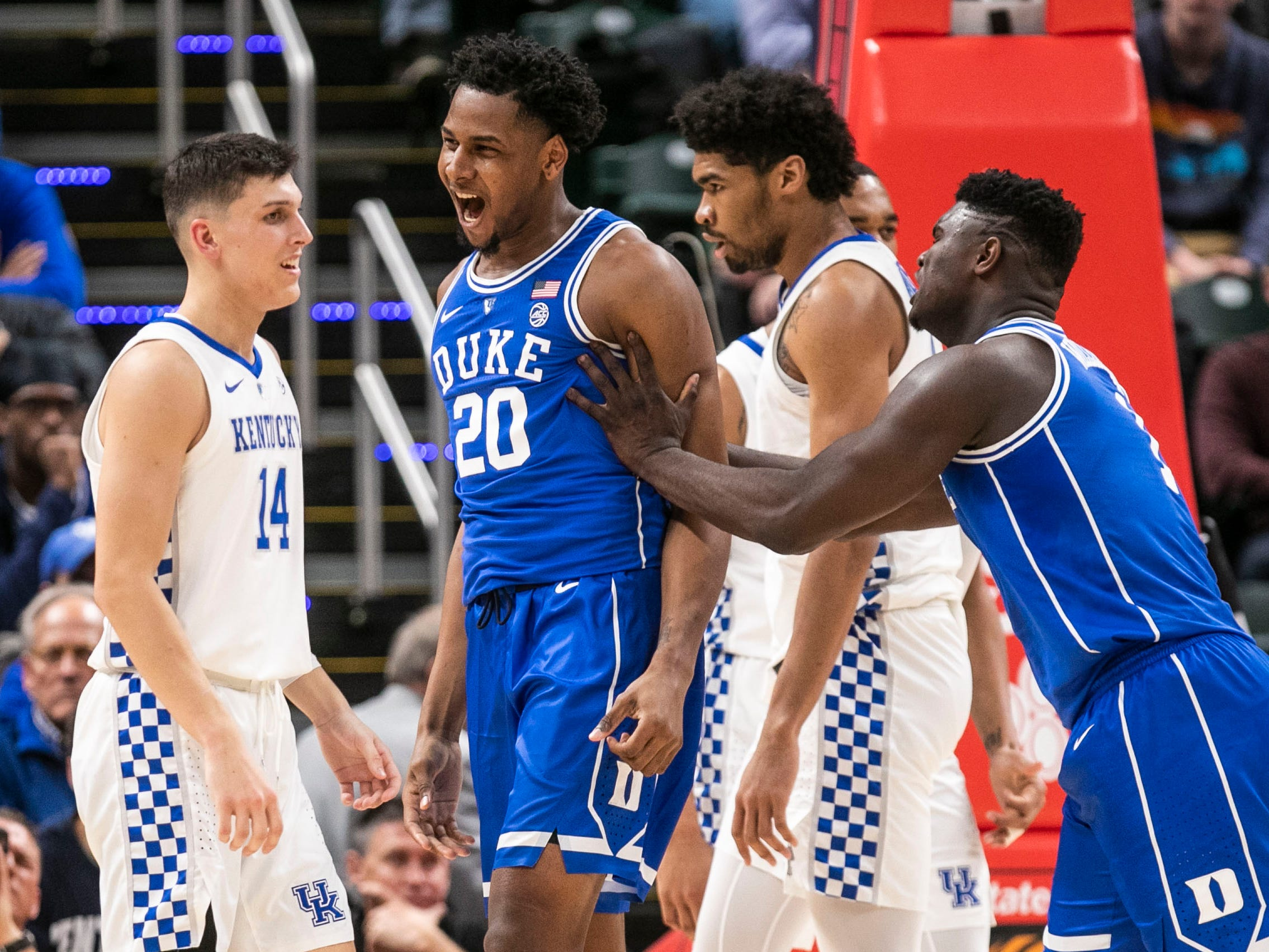 Duke's Marques Bolden celebrates after drawing the foul and two points against Kentucky's Tyler Herro in the first half in the Champions Classic Tuesday night. Nov. 6, 2018