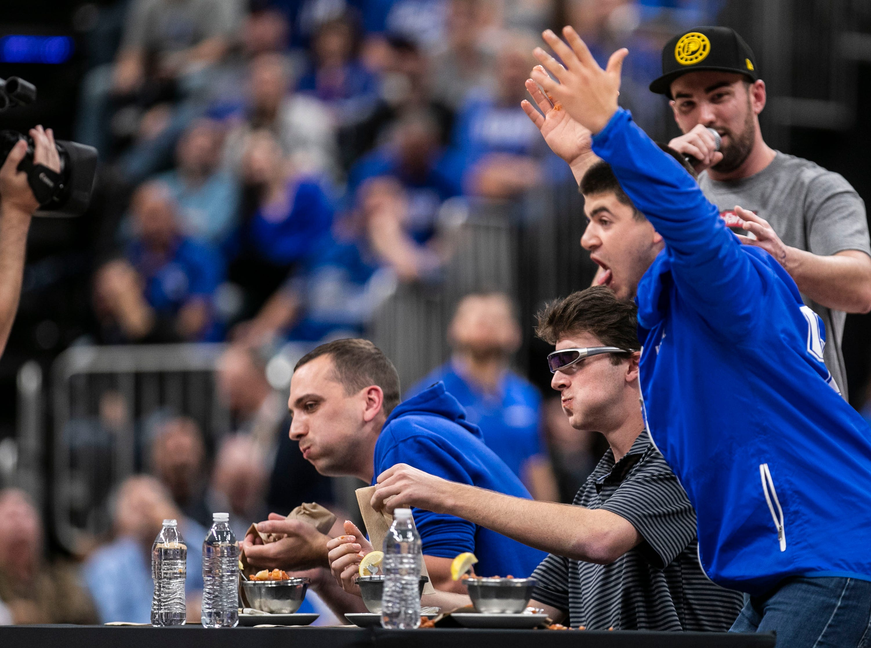 During a timeout, a shrimp eating contest was conducted between two UK fans and a Duke fan at the Champions Classic Nov. 6, 2018. St. Elmo's spicy cocktail sauce was added to the shrimp as part of the challenge.