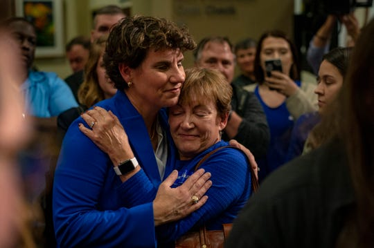 Congressional candidate Amy McGrath hugs and talks with her supporters following an election night watch party in Richmond, Kentucky. McGrath, the challenger, was ultimately defeated by Andy Barr by three percentage points. Nov. 6, 2018