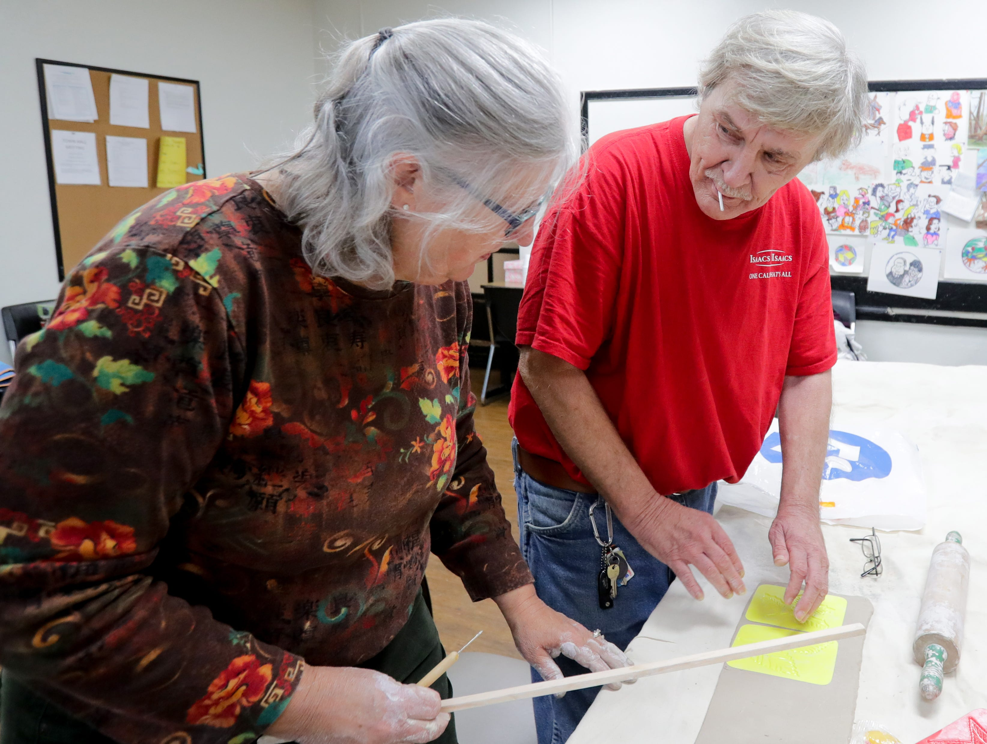 """James """"Jimbo"""" Fredrick works with PatÊSturtzel as part of the Kentucky Center for the Arts program called Arts in Healing. The program hires artists to help people, like vets, who have gone through traumatic experiences.Nov. 1, 208"""