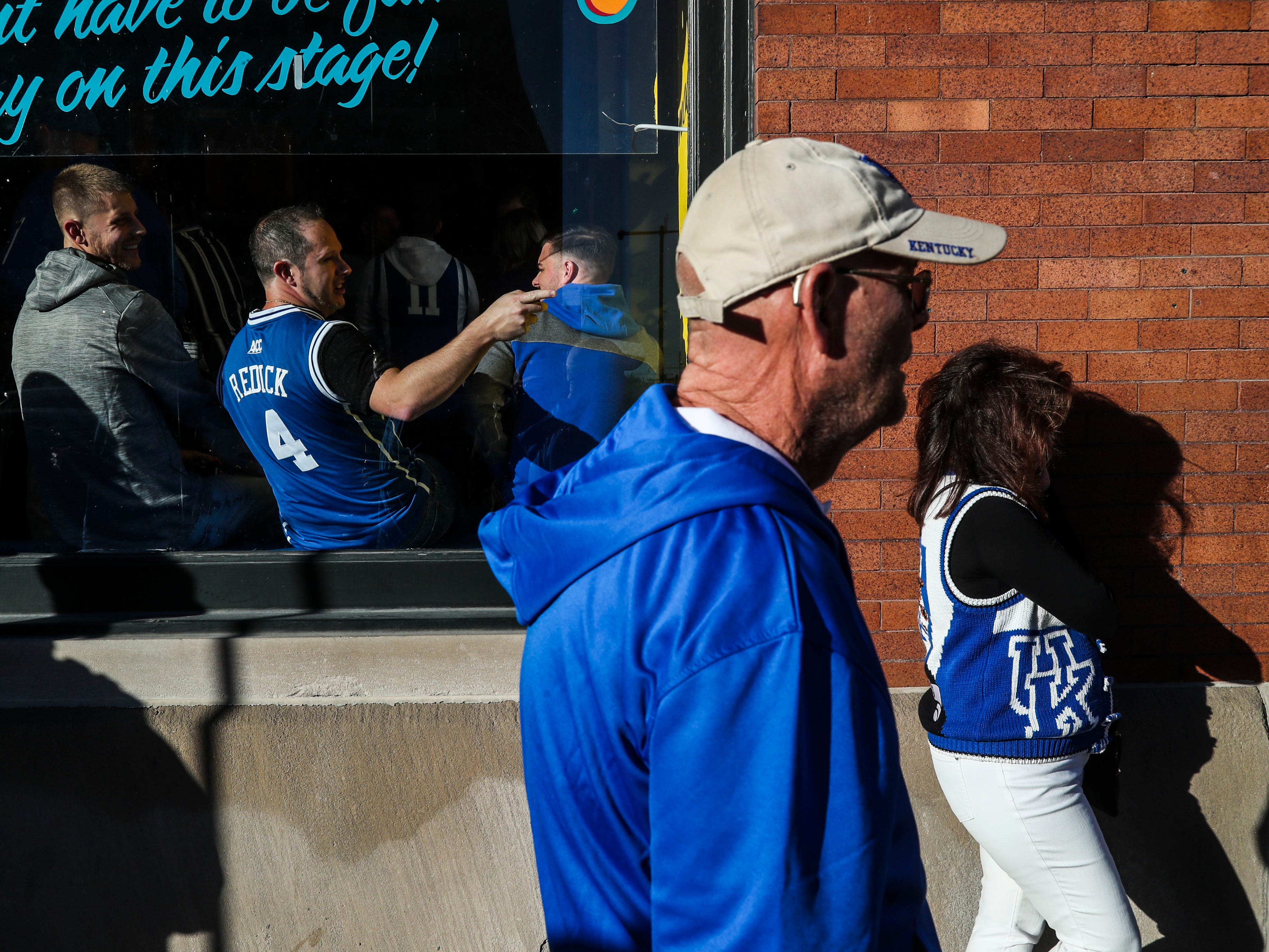 Kentucky fans wait outside a bar before the Champions Classic Tuesday night in Indianapolis.