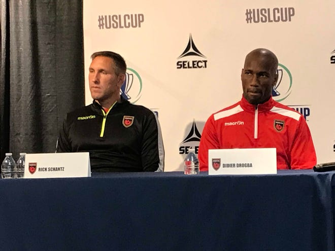 Phoenix Rising FC captain Didier Drogba and coach Rick Schantz speak at the Muhammad Ali Center before Thursday's USL Cup final at Lynn Stadium.