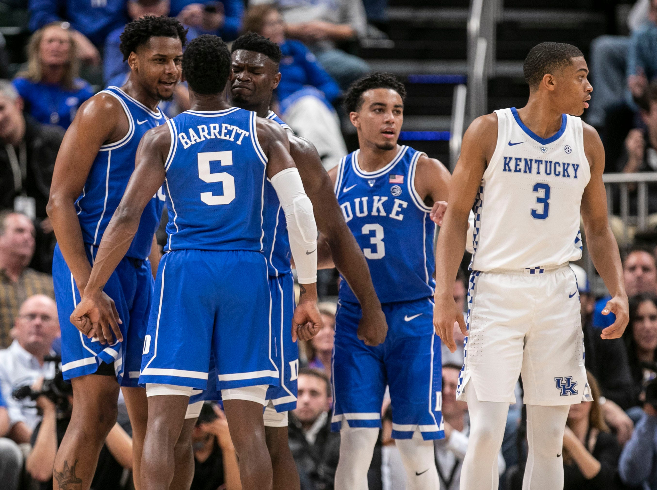 Duke's Zion Williamson had a look of determination as he celebrated a play with teammate RJ Barrett in the first half as the Blue Devils cruised past Kentucky 118-84 in the Champions Classic Nov. 6, 2018