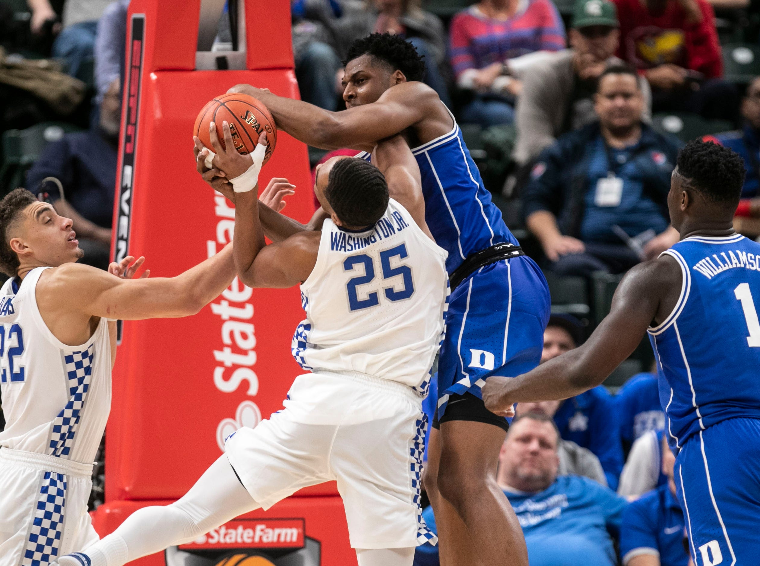 Duke's Marques Bolden pressured Kentucky's PJ Washington that resulted in a jump bal as the Blue Devils cruised past Kentucky 118-84 in the Champions Classic Nov. 6, 2018