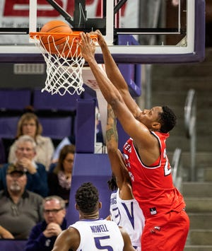 Western Kentucky's Charles Bassey dunks against Washington during the first half of an NCAA college basketball game Tuesday, Nov. 6, 2018, in Seattle. (Dean Rutz/The Seattle Times via AP)