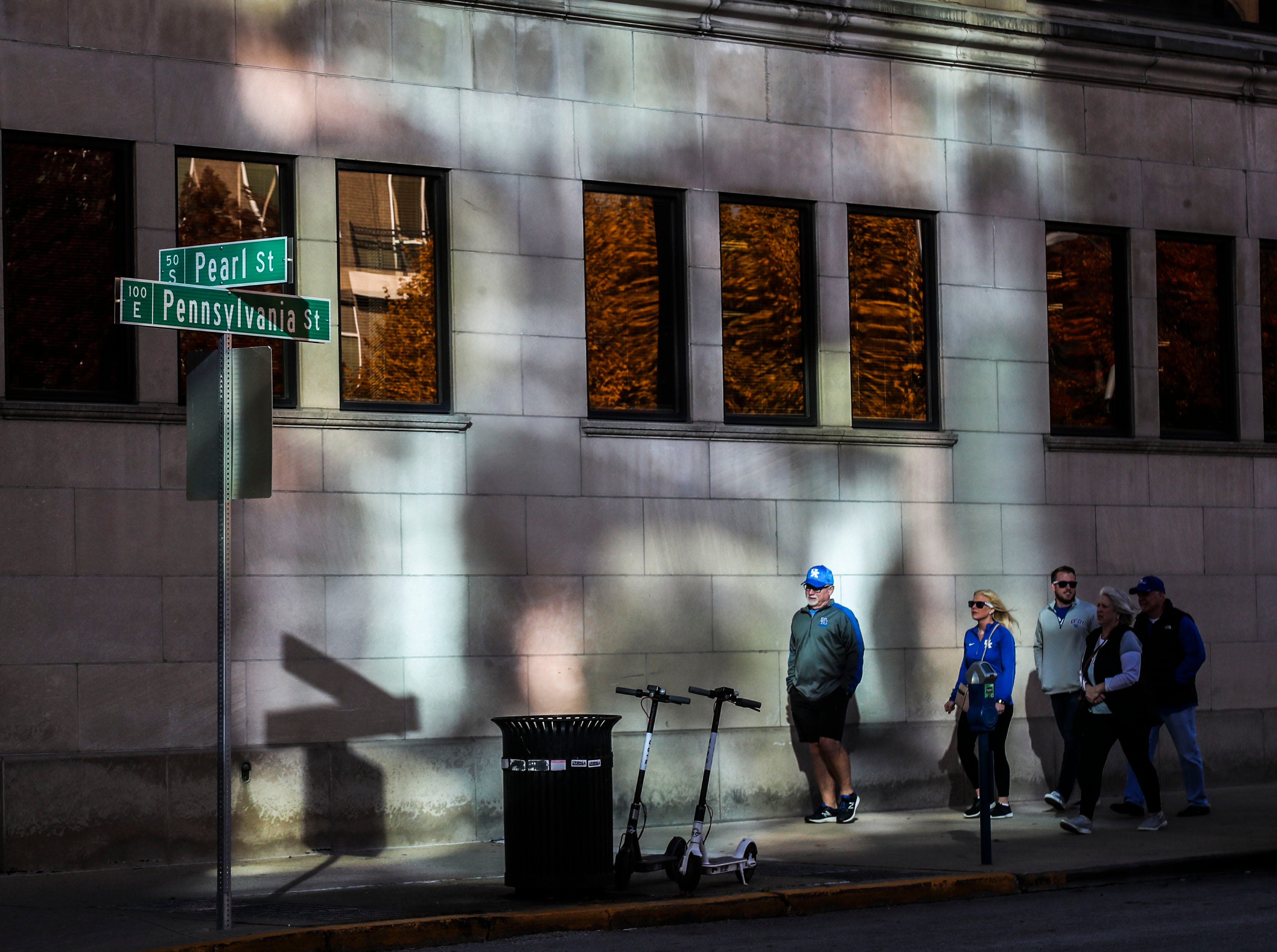 Kentucky fans walk in downtown Indianapolis before the Wildcats' game against Duke in the Champions Classic Tuesday night. Nov. 6, 2018