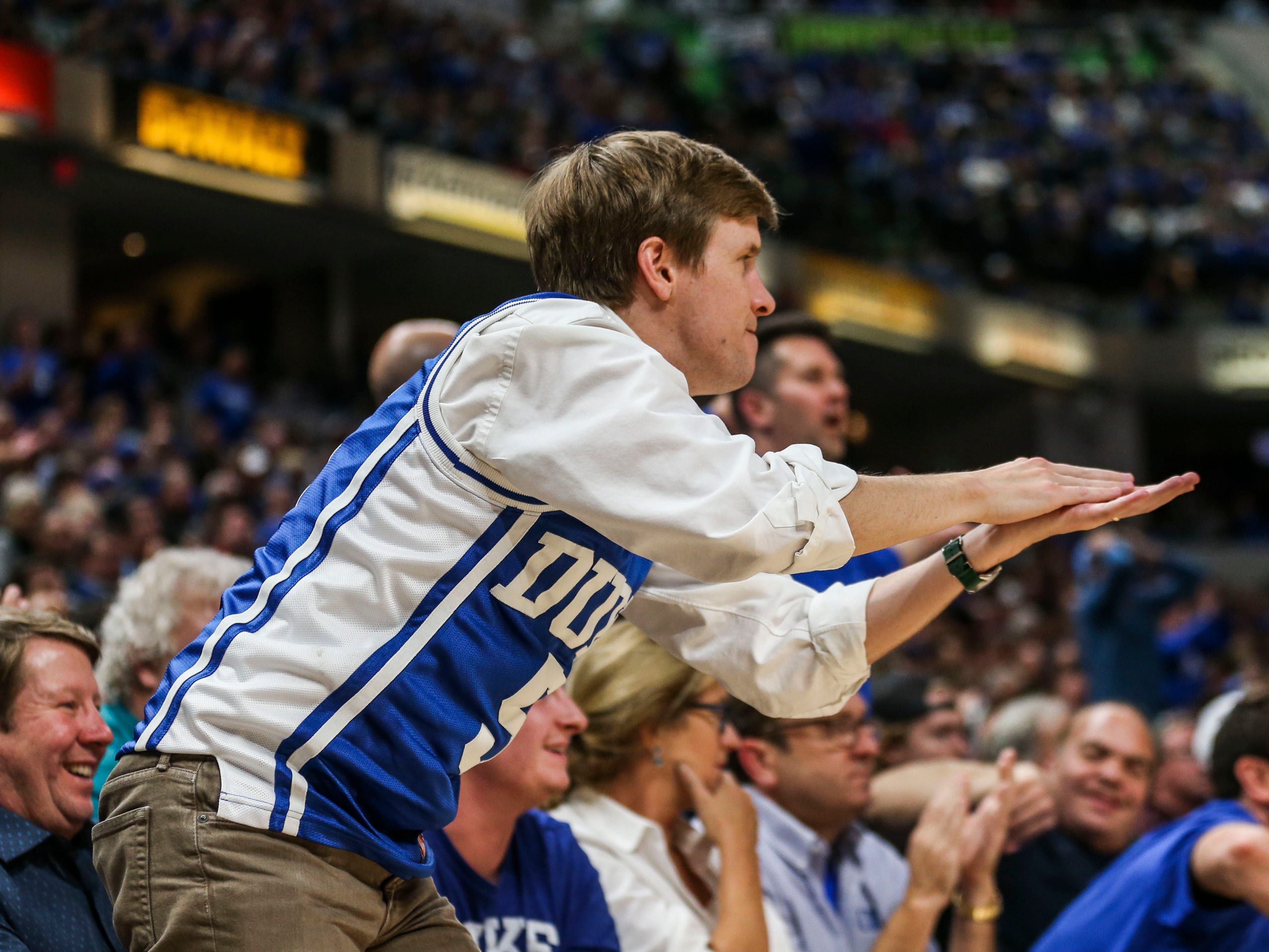A Duke fan cheered as a Kentucky fan could only wonder what happened to the Wildcats as the Blue Devils crushed them 118-84 at the Champions Classic Nov. 6, 2018.