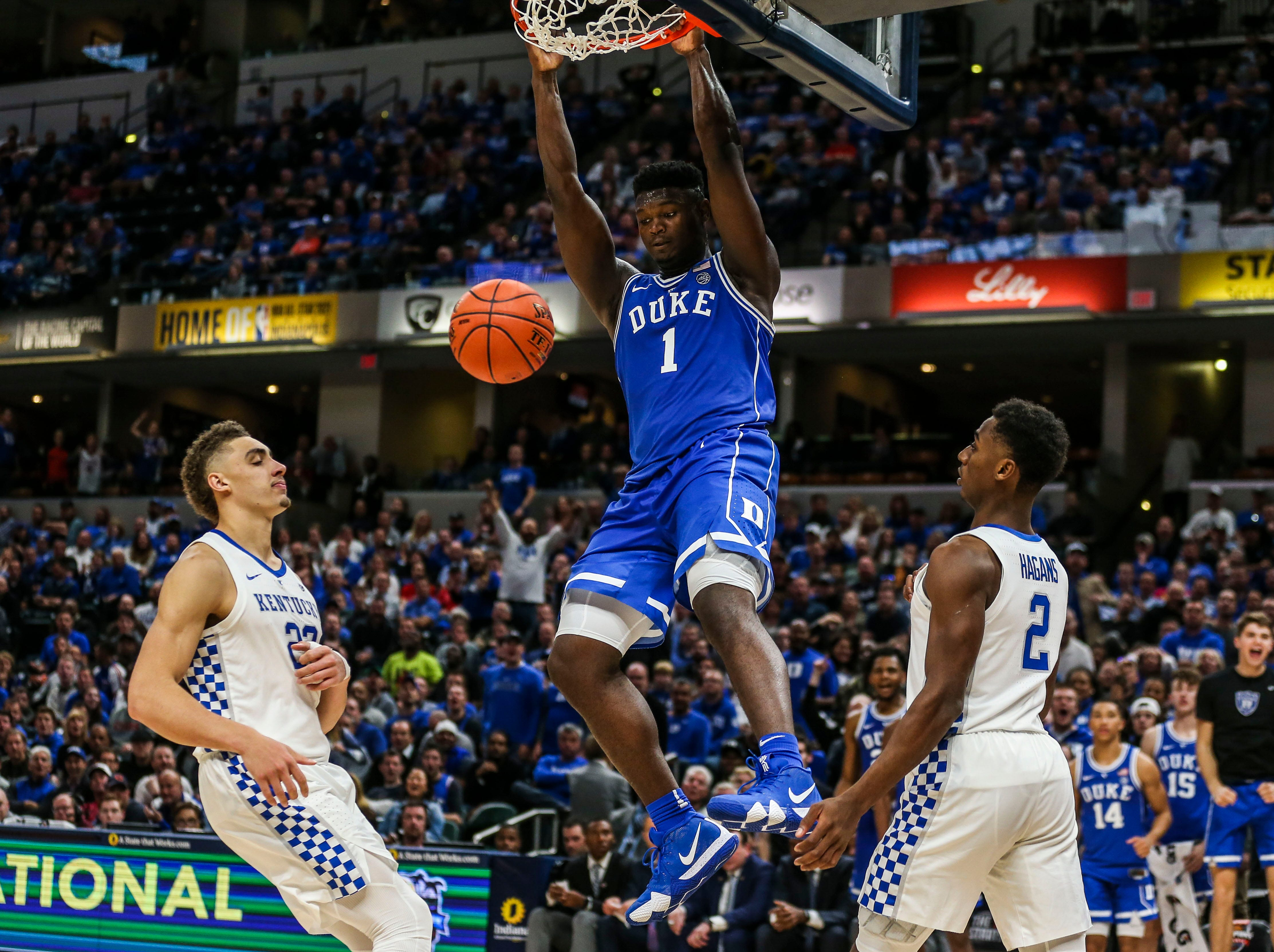 Duke's Zion Williamson played like a veteran as the freshman scored 29 points, including this dunk against an overmatched Kentucky team as the Blue Devils crushed the Wildcats 118-84 in the Champions Classic Tuesday night. Nov. 6, 2018