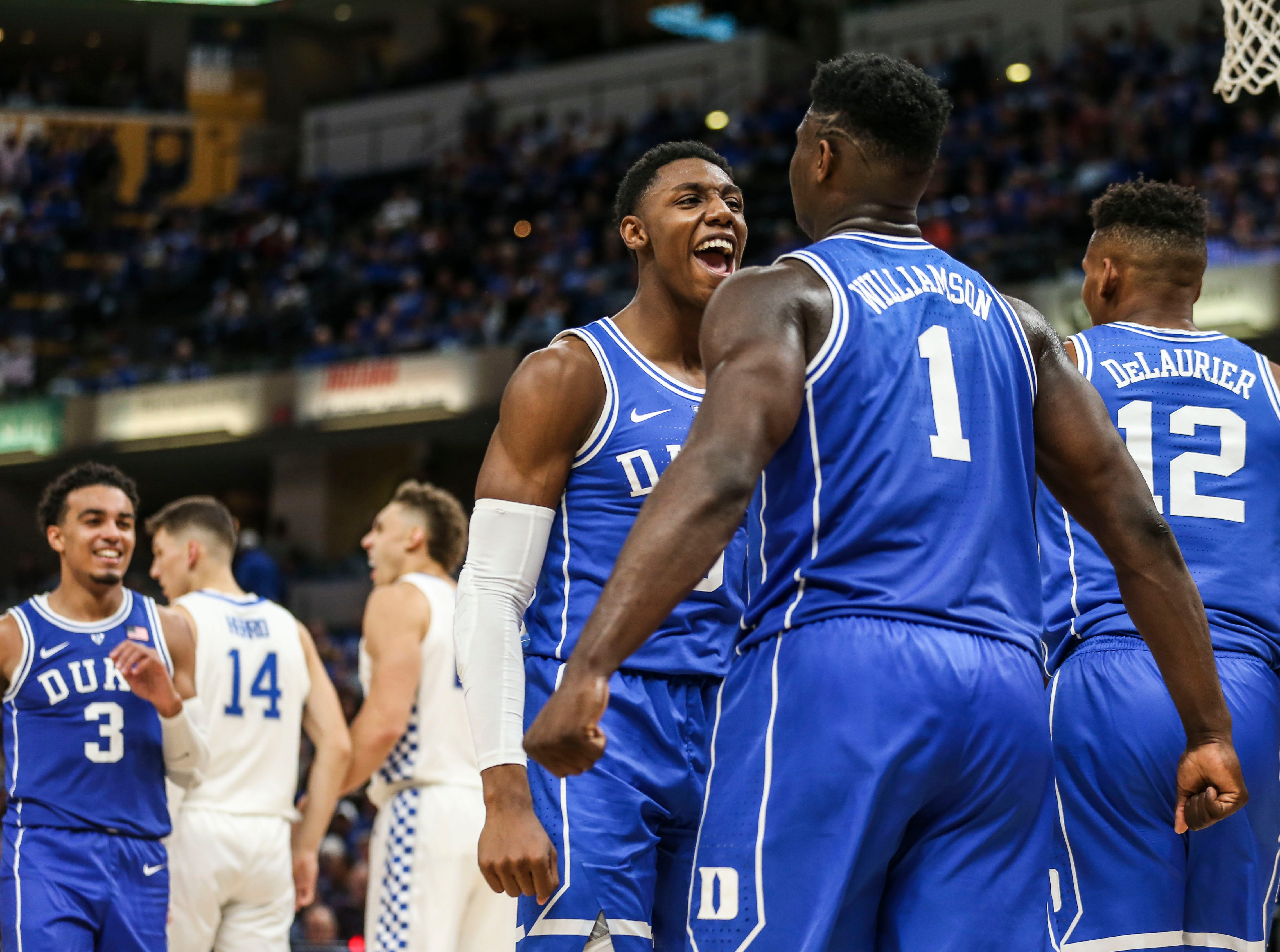 Duke's Zion Williamson, right, gets a bump from teammate R.J. Barrett, left, as the freshman -- who played like a  veteran senior -- scored 29 points against an overmatched Kentucky team as the Blue Devils crushed the Wildcats 118-84 in the Champions Classic Tuesday night. Barrett had 33 points. Nov. 6, 2018