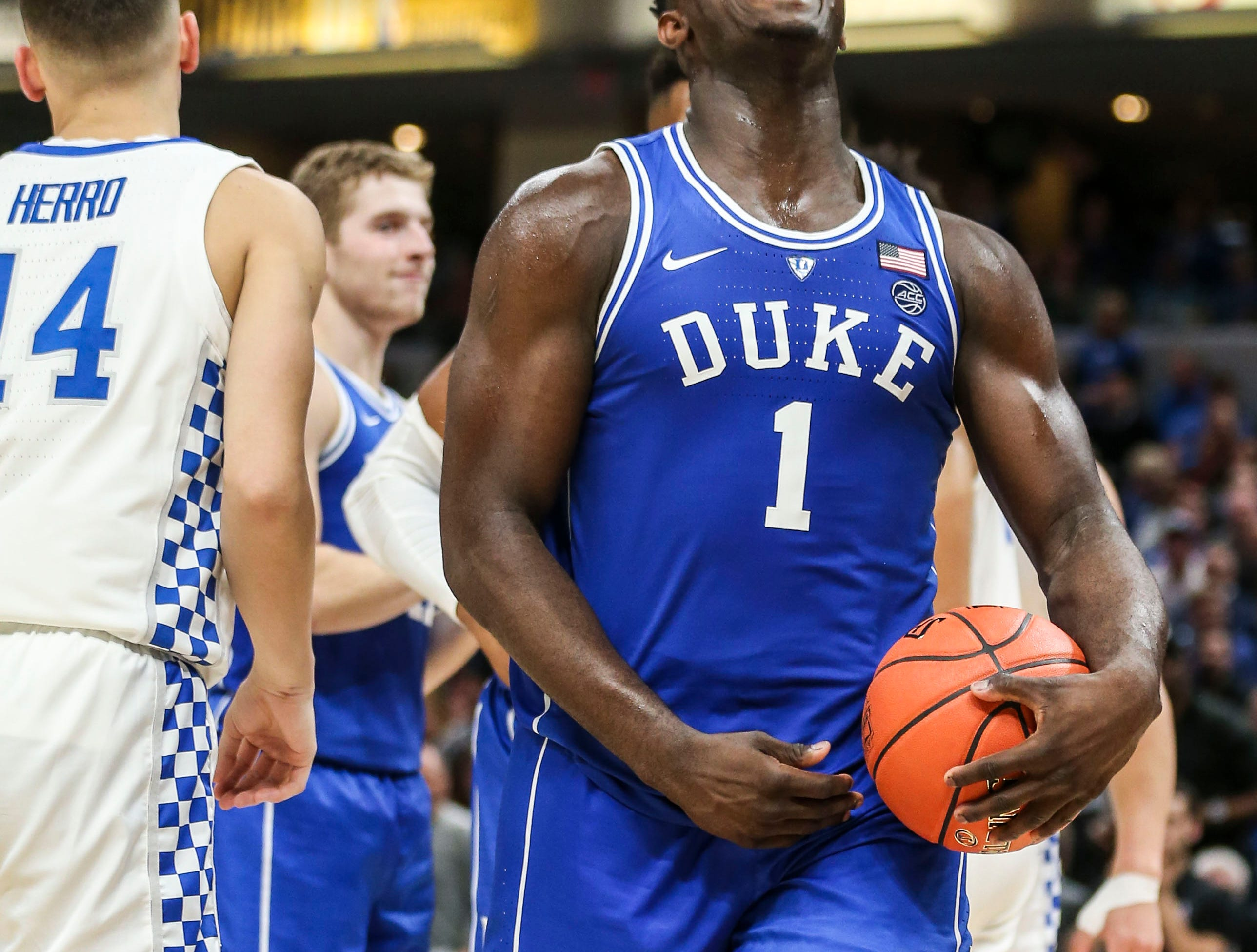 Duke's Zion Williamson roared after drawing the foul as the freshman -- who played like a  veteran senior -- scored 28 points against an overmatched Kentucky team as the Blue Devils crushed the Wildcats 118-84 in the Champions Classic Tuesday night. Nov. 6, 2018