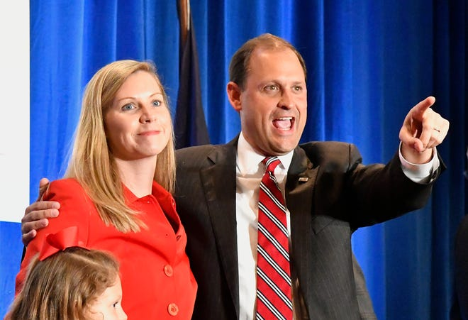 Rep. Andy Barr, R-Ky., right, and his wife, Carol, look out over the crowd of his supporters at his victory celebration in Lexington, Ky., Tuesday, Nov. 6, 2018.