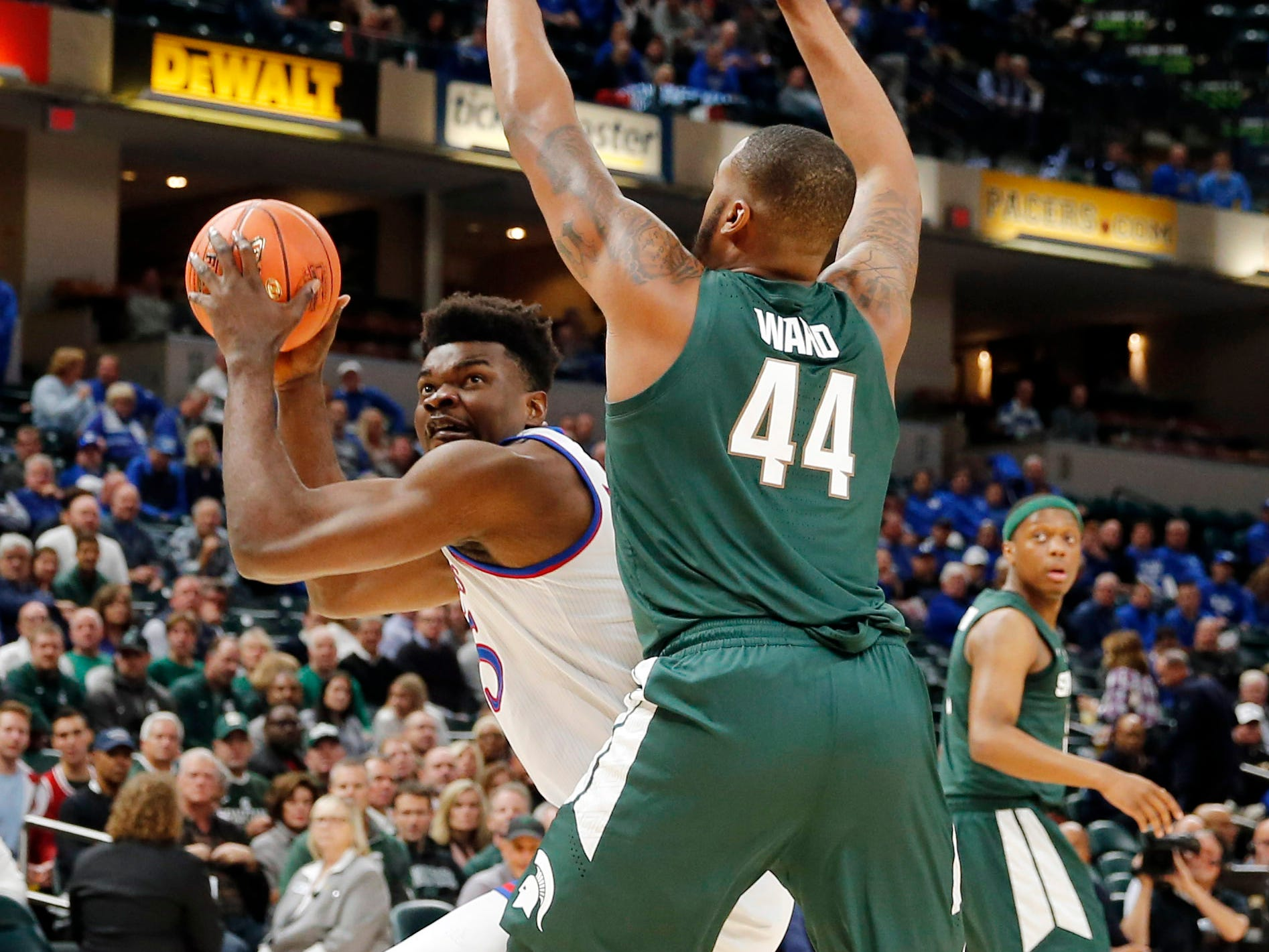 Kansas Jayhawks center Udoka Azubuike (35) takes a shot against Michigan State Spartans forward Nick Ward (44) in the first half during the Champions Classic at Bankers Life Fieldhouse.