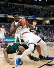 Michigan State center Nick Ward flops to draw a foul against Kansas' Udoka Azubuike during the second half Tuesday.