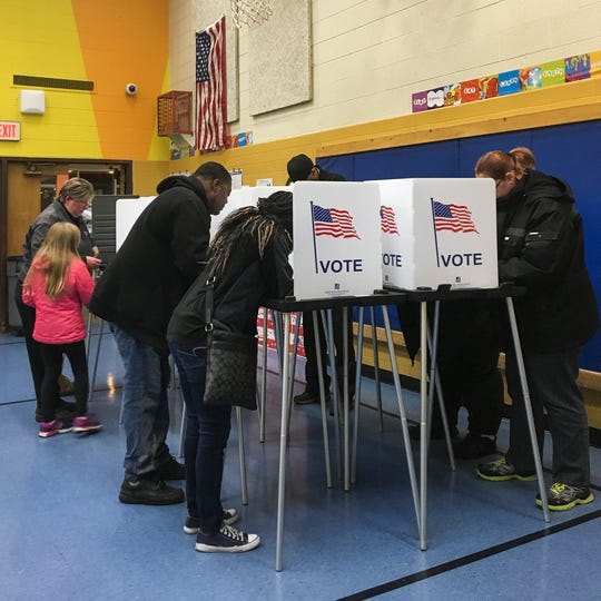 Voters cast their ballots Tuesday, Nov. 6, 2018, at Willow School in Lansing for the midterm election.