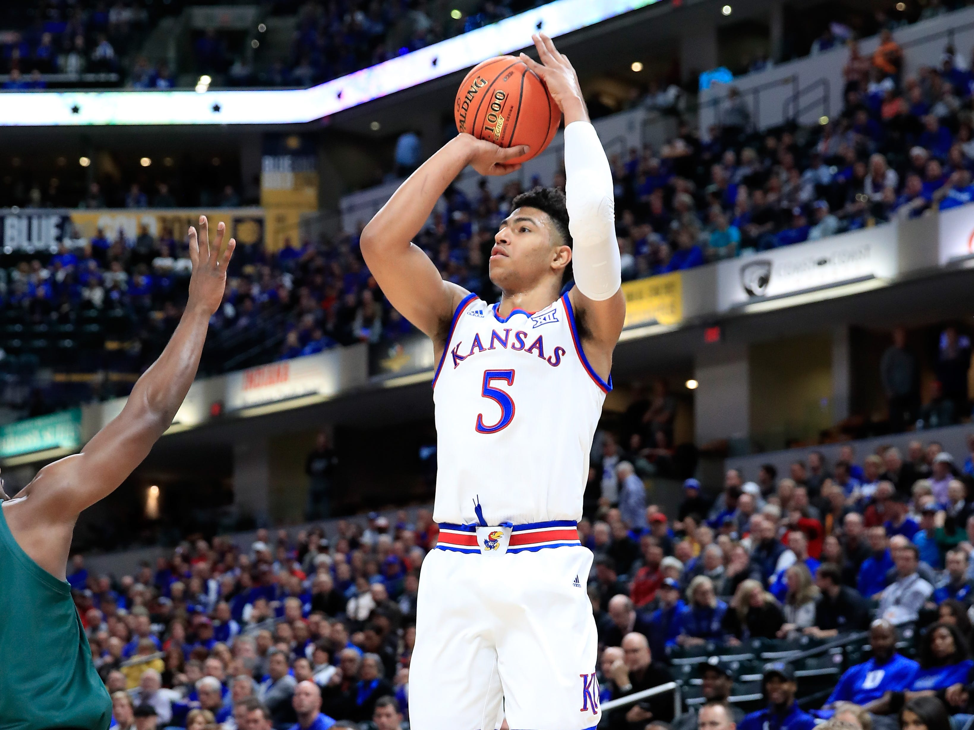 Quentin Grimes #5 of the Kansas Jayhawks shoots the ball against the Michigan State Spartans during the State Farm Champions Classic at Bankers Life Fieldhouse on November 6, 2018 in Indianapolis, Indiana.