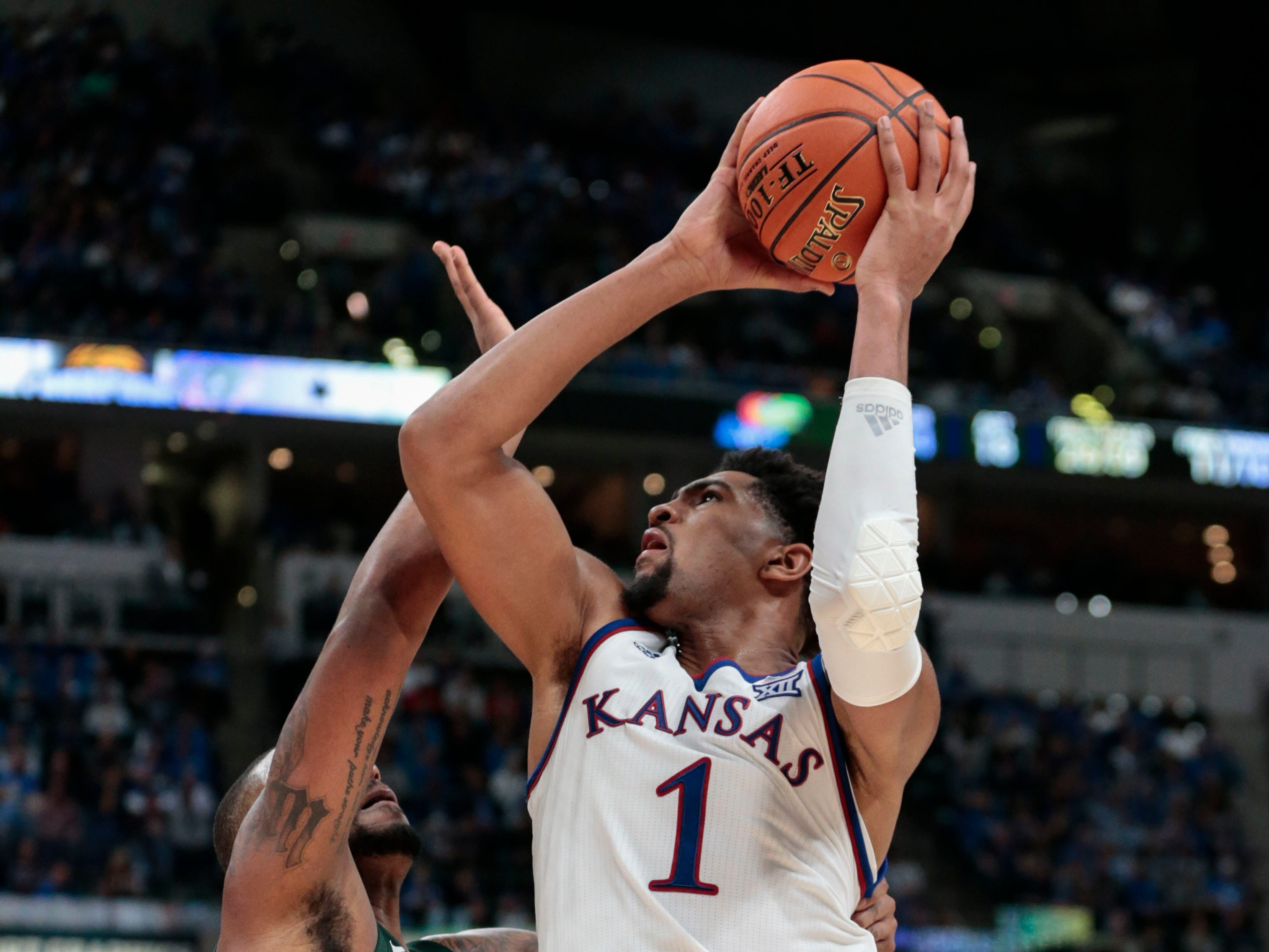 Kansas forward Dedric Lawson (1) shoots over Michigan State forward Nick Ward (44) during the second half of an NCAA college basketball game at the Champions Classic in Indianapolis on Tuesday, Nov. 6, 2018. Kansas won 92-87.