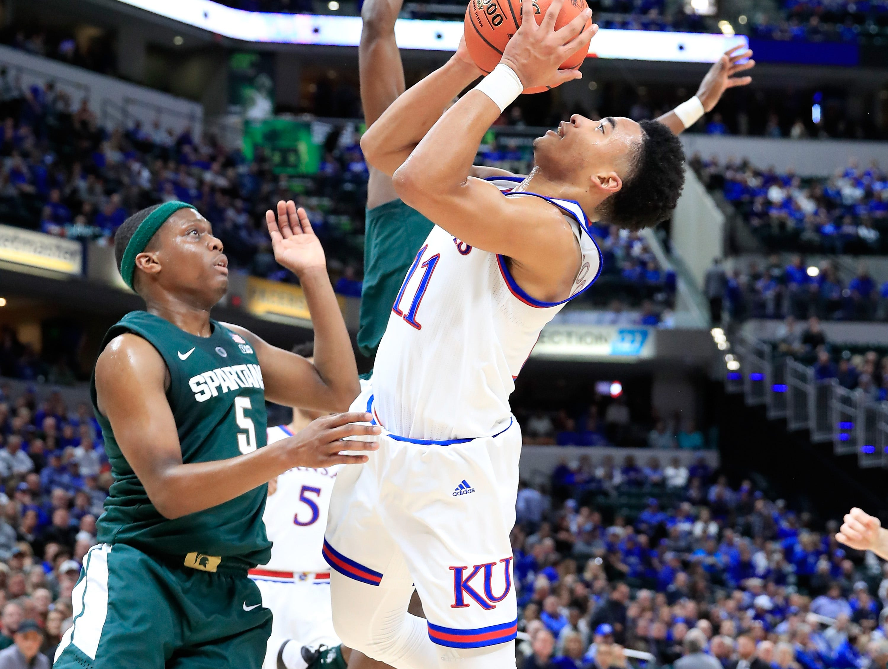 Devon Dotson #11 of the Kansas Jayhawks shoots the ball against the Michigan State Spartans during the State Farm Champions Classic at Bankers Life Fieldhouse on November 6, 2018 in Indianapolis, Indiana.