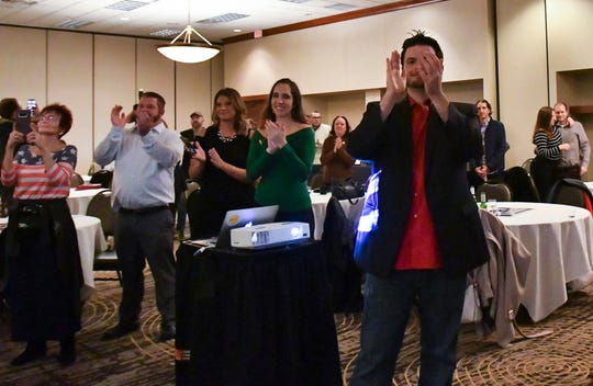 Michigan recreational marijuana supporters celebrate the legalization of Proposal 1, Tuesday evening, Nov. 6, 2018, during a watch party at the Radisson Hotel in downtown Lansing.