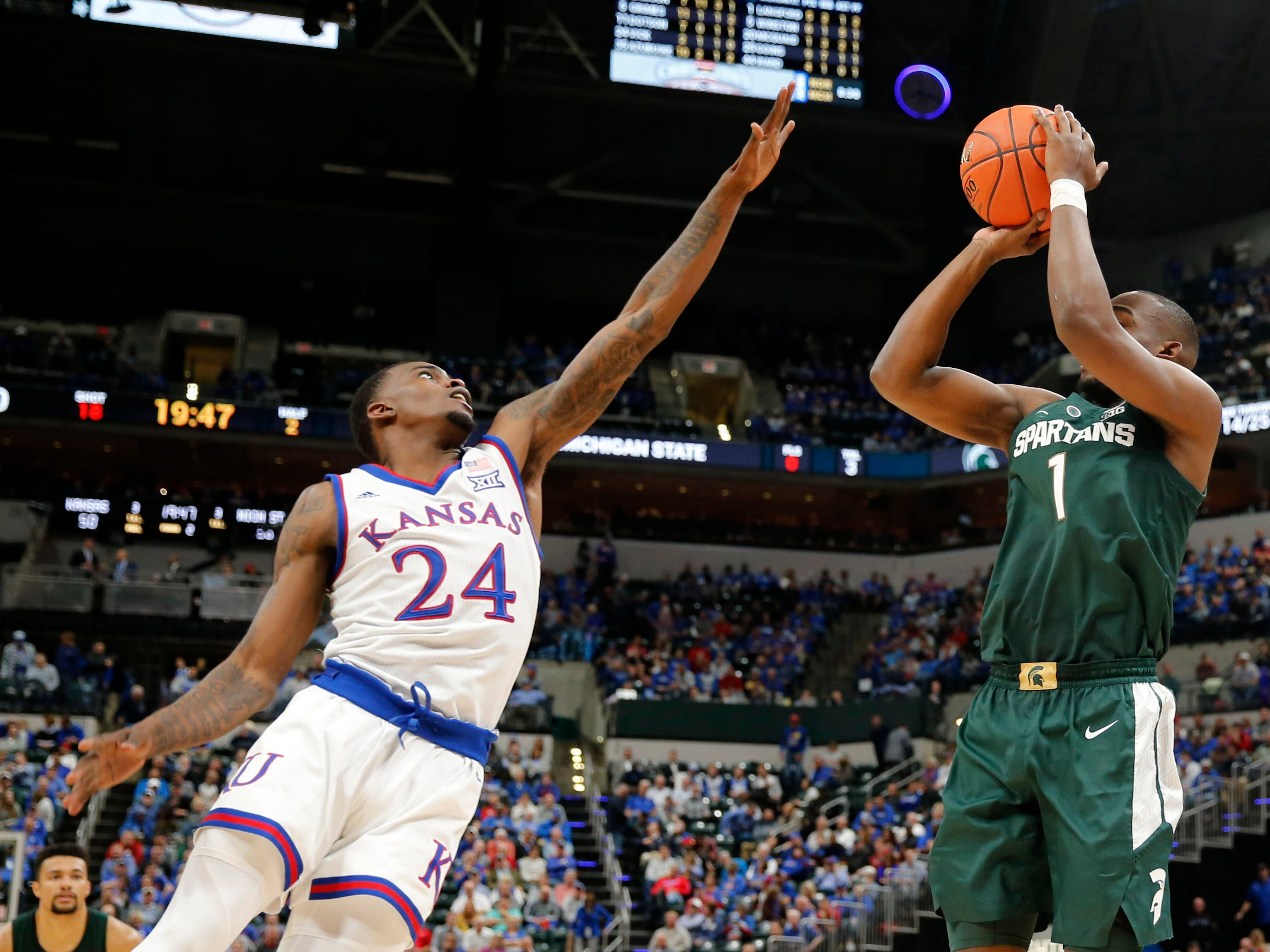 Michigan State Spartans guard Joshua Langford (1) takes a shot against Kansas Jayhawks guard Lagerald Vick (24) in the second half during the Champions Classic at Bankers Life Fieldhouse.