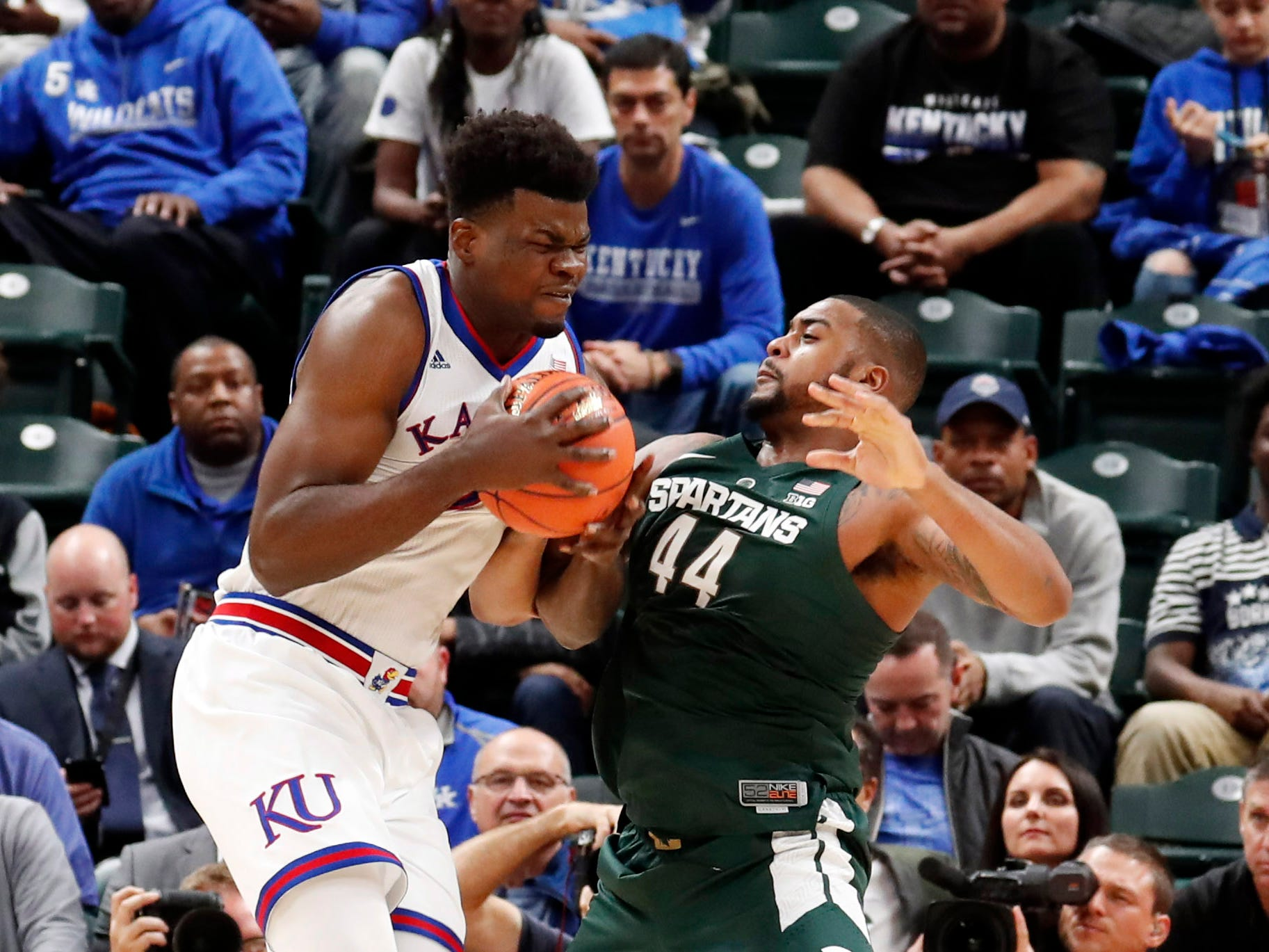 Kansas Jayhawks center Udoka Azubuike (35) is guarded by Michigan State Spartans forward Nick Ward (44) in the second half during the Champions Classic at Bankers Life Fieldhouse.