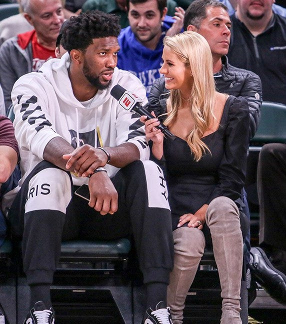 Joel Embiid sat courtside at the Michigan State and Kansas men's basketball game on Nov. 6, 2018, in Indianapolis.