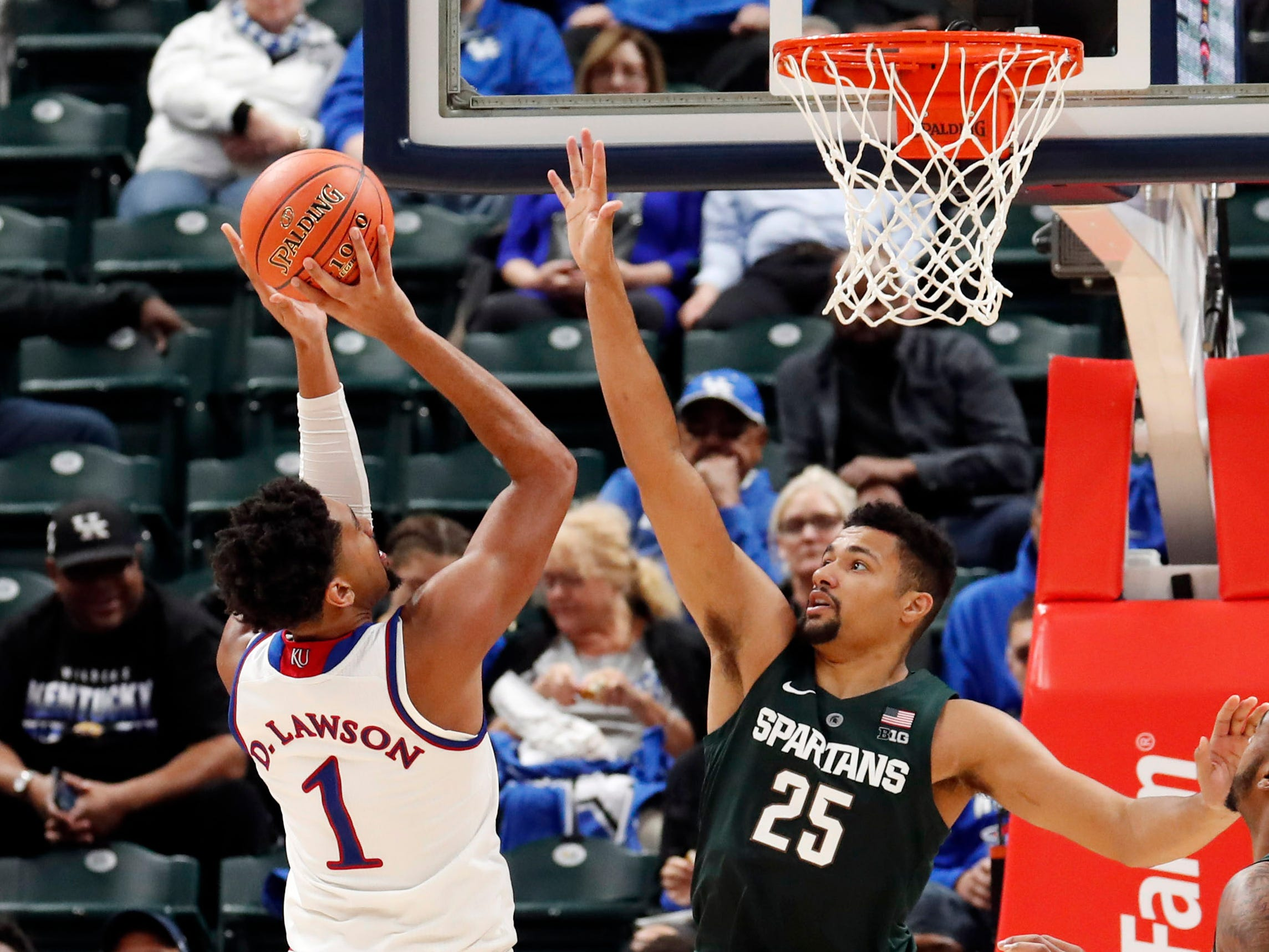 Kansas forward Dedric Lawson takes a shot over Michigan State forward Kenny Goins in the second half of their game on Tuesday, Nov. 6, 2018.