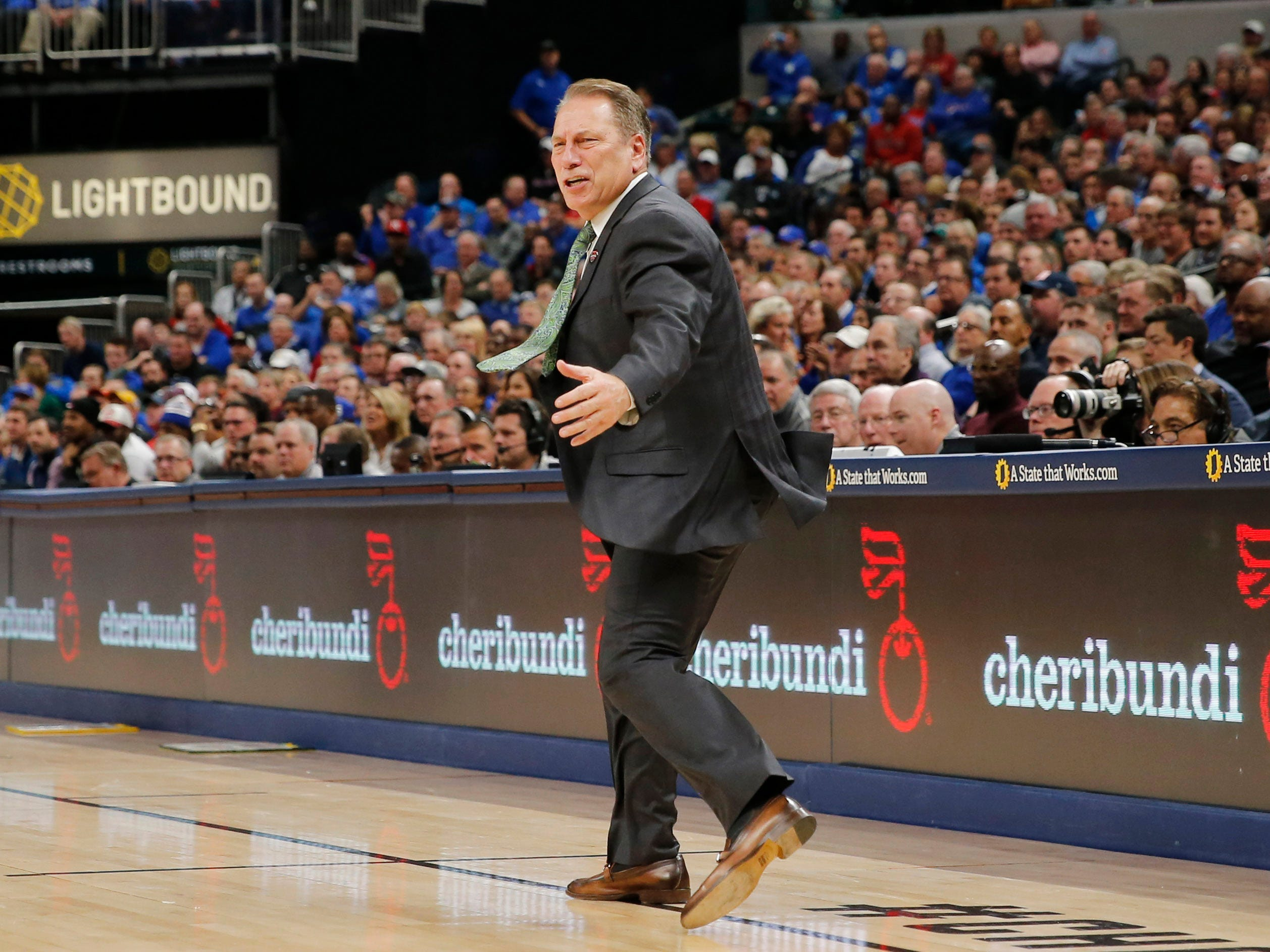 Michigan State Spartans Tom Izzo coaches on the sidelines against the Kansas Jayhawks in the second half during the Champions Classic at Bankers Life Fieldhouse.