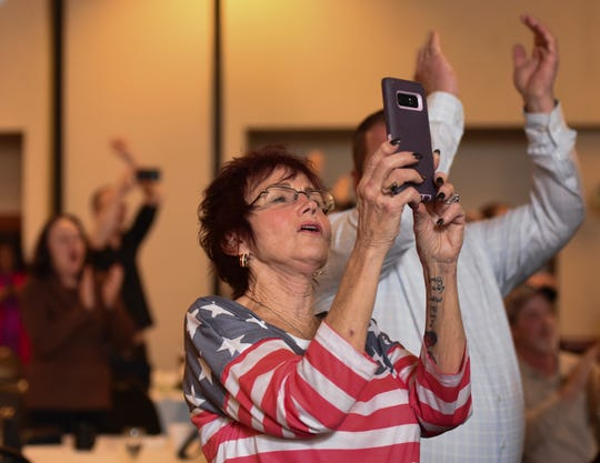 """""""This is going to help our country, and help get people off of opiods,"""" Gayle Buchan, 71, middle,  from Livonia, Michigan said Tuesday evening, Nov. 6, 2018, after Michigan voters approved the legalization of recreational marijuana. Buchan was at a Proposal 1 watch party at the Radisson Hotel in downtown Lansing."""