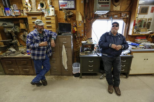 Longtime friends Bill Mecha, left, and Bob Schuh talk in Schuh's shop before leaving for a hunt Oct. 11 in Whitelaw.