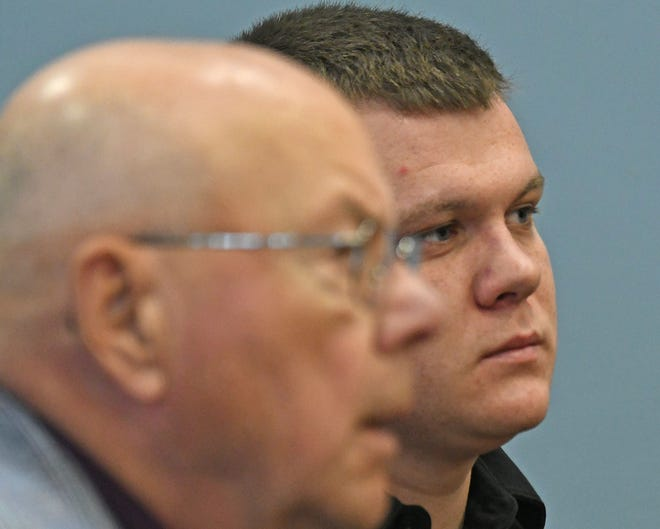 Matthew Pickworth and his attorney, Robert Whitney, listen to visiting judge Howard Hall during a change of plea hearing Wednesday afternoon. The hearing was rescheduled for Wednesday, Nov. 14.