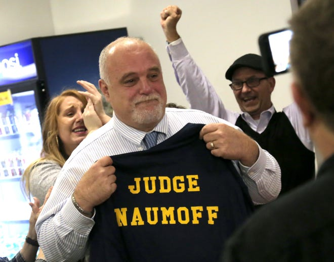 Phillip Naumoff, newly elected as Richland County Common Pleas Court judge, celebrates his victory with his supporters at the Richland County Democratic Party headquarters on Tuesday night.
