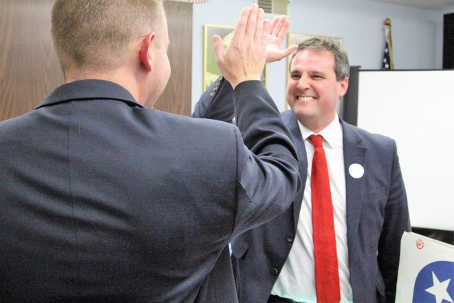 Ray Grogan celebrates his win for Marion County prosecutor Tuesday at the Marion County Republican Party headquarters.