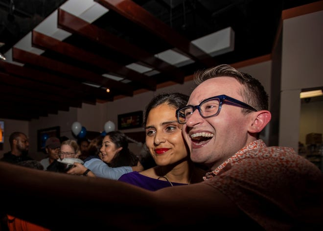 State Senate candidate Gabby Salinas takes a selfie with a supporter during her watch party Tuesday night in Memphis.