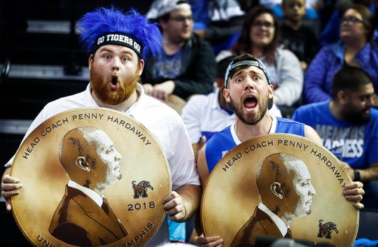 Memphis fans cheer while holding commemorative Penny Hardaway posters before taking on Tennessee Tech  at the FedExForum in Memphis Tenn., Tuesday, November 6, 2018.