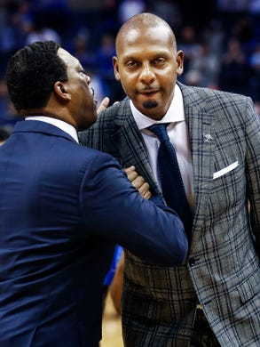 Memphis head coach Penny Hardaway (right) is greeted by assistant coach Tony Madlock before taking on Tennessee Tech at the FedExForum in Memphis Tenn., Tuesday, November 6, 2018.