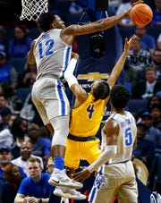 Memphis forward Victor Enoh (left) blocks the shot of Tennessee Tech guard Jr. Clay (right) during action at the FedExForum in Memphis Tenn., Tuesday, November 6, 2018.