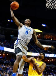 Memphis forward Kyvon Davenport  goes up for a massive dunk in front of Tennessee Tech defender Micaiah Henry during action at the FedExForum in Memphis Tenn., Tuesday, November 6, 2018.