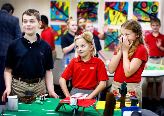 Grace-St. Luke's Episcopal School fourth grade students Reed Hoffman, Iris Vining and Ruby Brunson present their playground prototypes to a design team of contractors, in the hopes that elements will be used in new construction at the school.