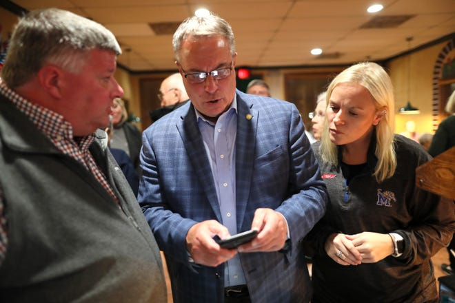 Germantown Mayor Mike Palazzolo, center watches for election results with Greg Marcom and Susan Brooke from Garibaldi's Pizza as the votes are being tallied in his mayoral campaign on election night Tuesday, Nov. 6, 2018.