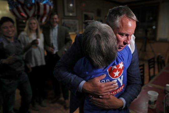 Germantown Mayor Mike Palazzolo hugs Phillis Vincent as he celebrates with his supporters in a lead to retain his position during an election night watch party at Garibaldi's Pizza Tuesday, Nov. 6, 2018.