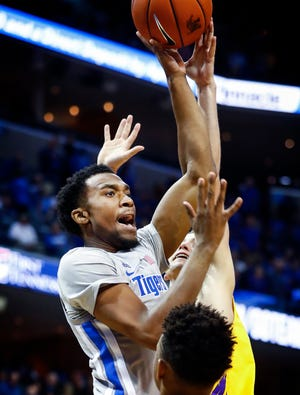 Memphis guard Jeremiah Martin drives the lane against the Tennessee Tech defense during action at the FedExForum in Memphis Tenn., Tuesday, November 6, 2018.