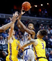 Memphis guard Kareem Brewton Jr. (middle) makes a pass agains the Tennessee Tech defense during action at the FedExForum in Memphis Tenn., Tuesday, November 6, 2018.